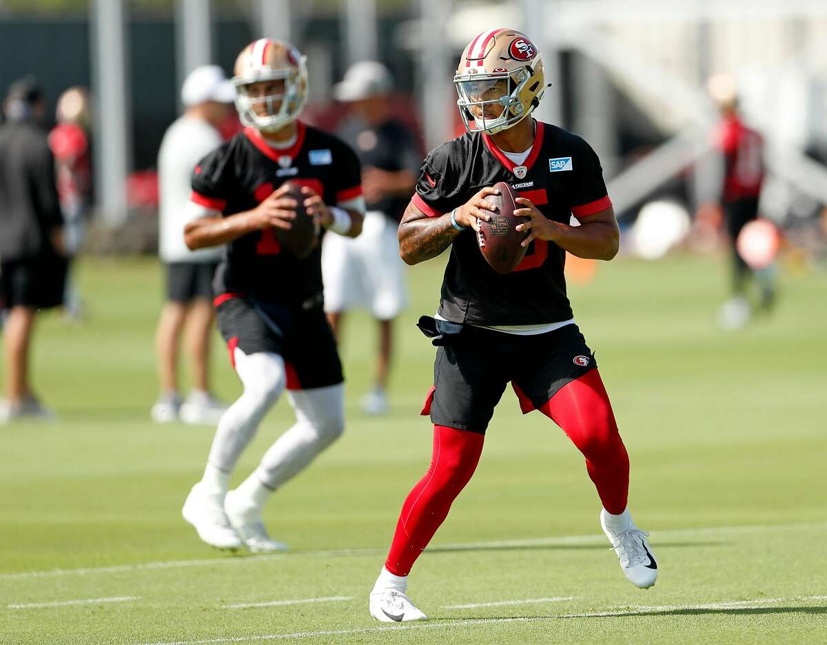 San Francisco 49ers' Trey Lance (5) and Jimmy Garoppolo (10) during training camp at Levi's Stadium practice field in Santa Clara, Calif., on Wednesday, July 28, 2021.