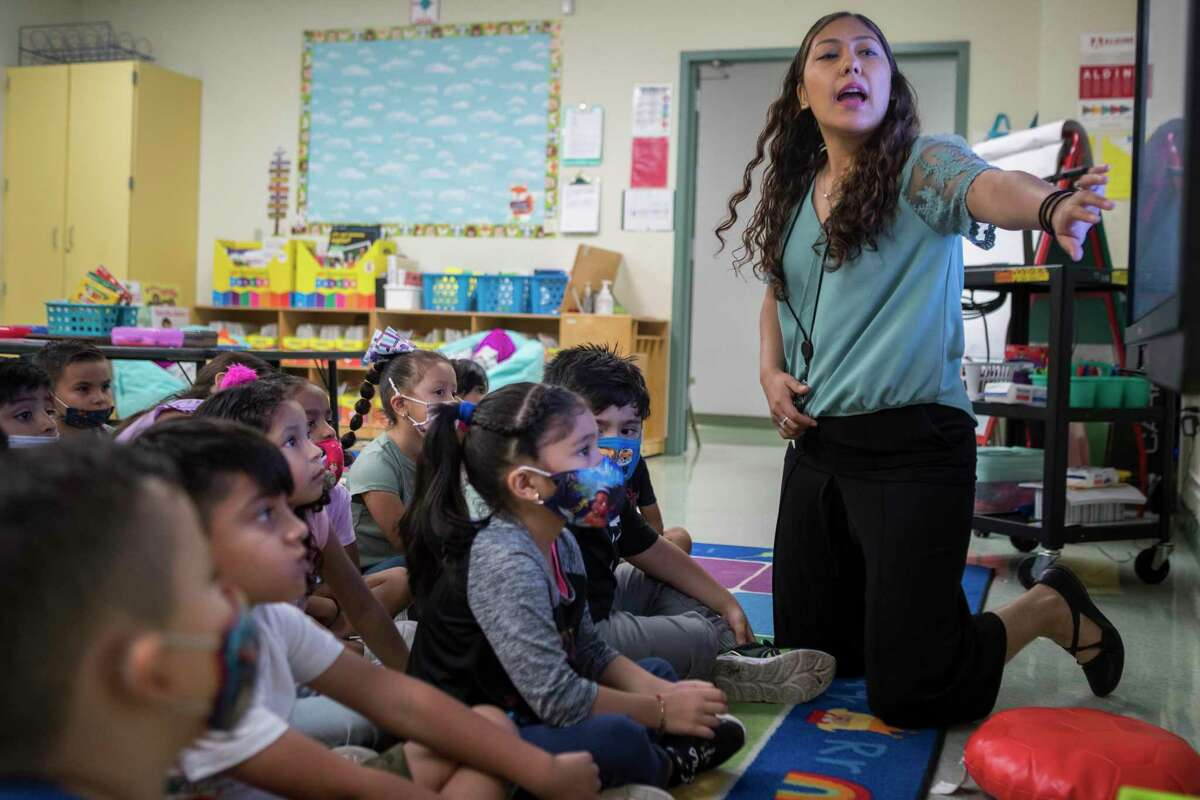 Kindergarten dual language teacher Yanelli Lopez works with her students at Vines Primary School in Aldine ISD Thursday, July 22, 2021 in Houston. Experts have said that this year's STAAR results data is incomplete and doesn't show a full picture of how students are faring during the pandemic. This year's test was optional for the first time ever, skewing results. The test was in-person, so many students who opted to learn virtually did not participate in STAAR testing. A glitch affecting technical glitch 250,000 students could also potentially throw off the data as well.