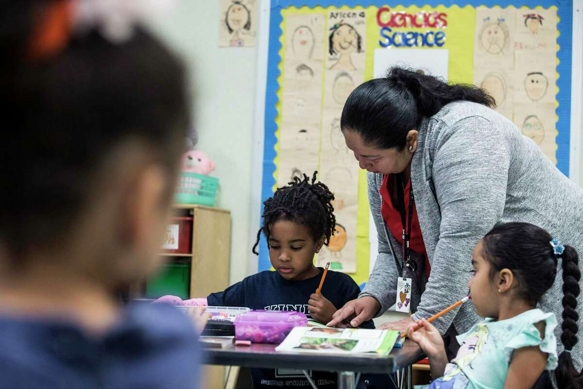 Instructional paraprofessional Maria Espinoza works with Raquelle Brooks in a kindergarten dual language class at Vines Primary School in Aldine ISD Thursday, July 22, 2021 in Houston. Experts have said that this year's STAAR results data is incomplete and doesn't show a full picture of how students are faring during the pandemic. This year's test was optional for the first time ever, skewing results. The test was in-person, so many students who opted to learn virtually did not participate in STAAR testing. A glitch affecting technical glitch 250,000 students could also potentially throw off the data as well.