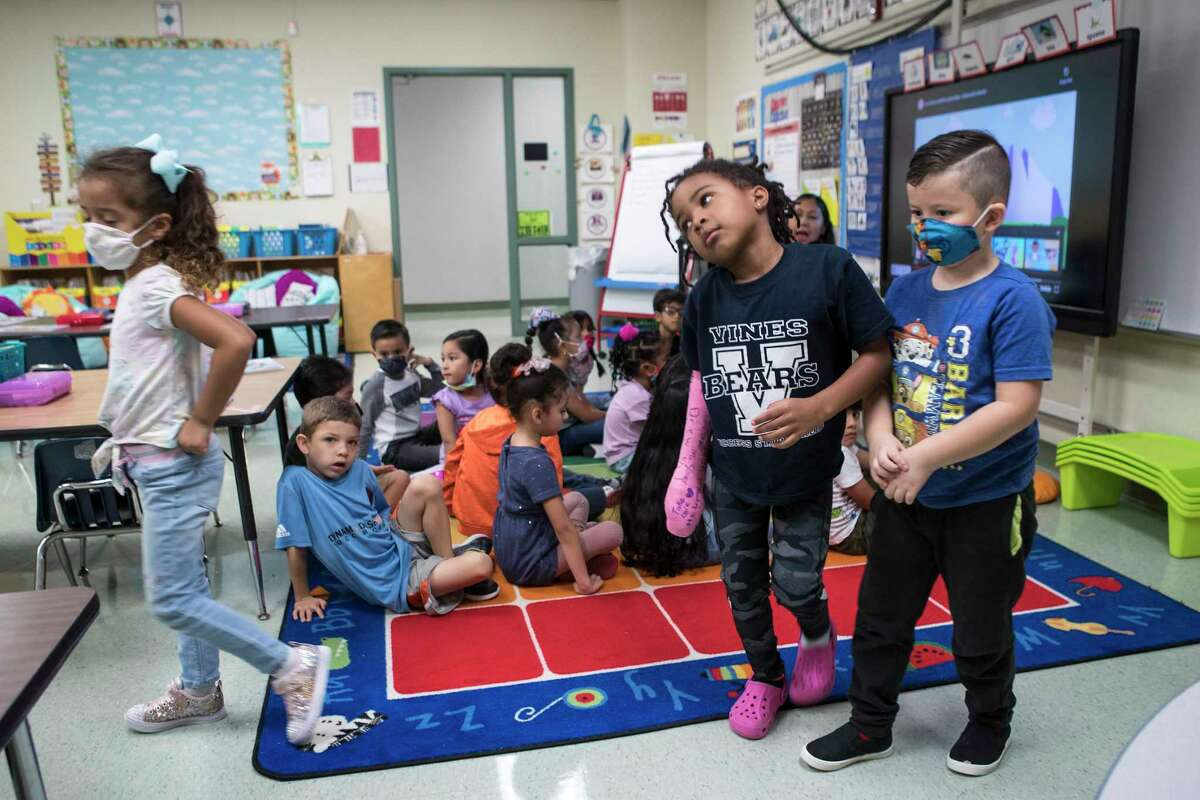 Some summer kindergarten dual language students in Yanelli Lopez' class wear masks as they walk back to their seats in class at Vines Primary School in Aldine ISD Thursday, July 22, 2021 in Houston. Cases of COVID-19 in students are increasing as schools in the Houston region begin to open for the new school year and children under 12 cannot yet recieve the vaccine.