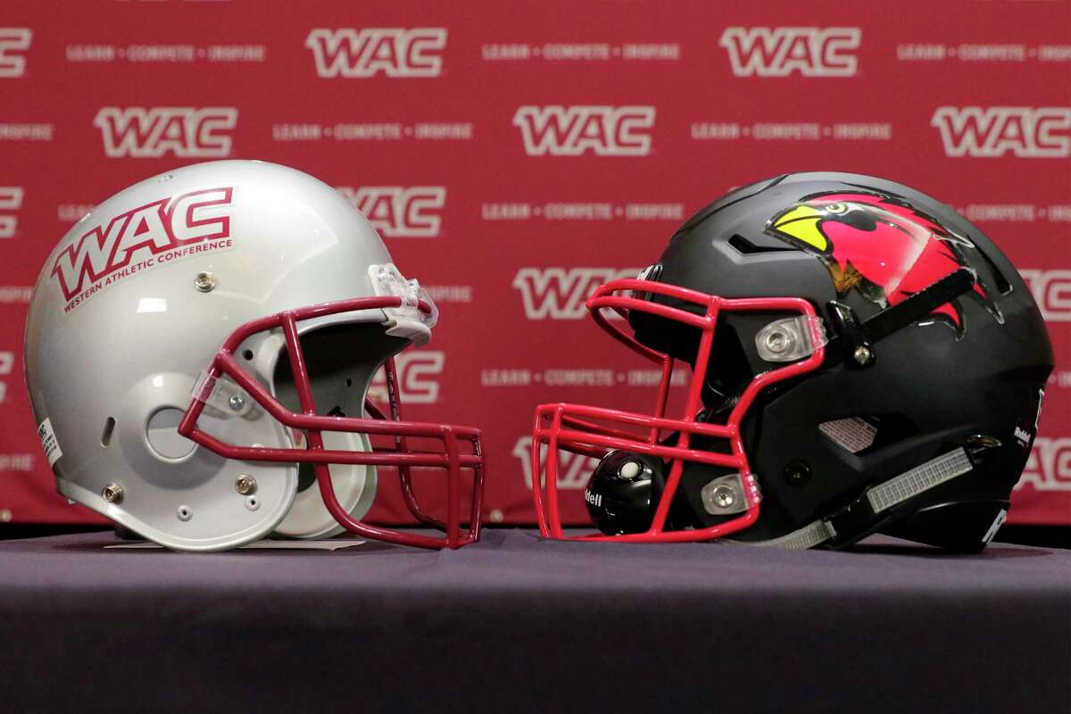 WAC, left, and Lamar University, right, prop helmets on a table on the dais during a press conference at the WAC football media day Wednesday, Jul. 28, 2021, held at the Marriott Hotel in The Woodlands, TX.