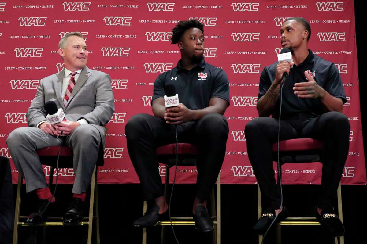 """From left, Lamar University head coach Blane Morgan, tight end Jeremy Davis and defensive back Anthony """"TJ"""" Ruffin answers questions during a press conference at the WAC football media day Wednesday, Jul. 28, 2021, held at the Marriott Hotel in The Woodlands, TX."""
