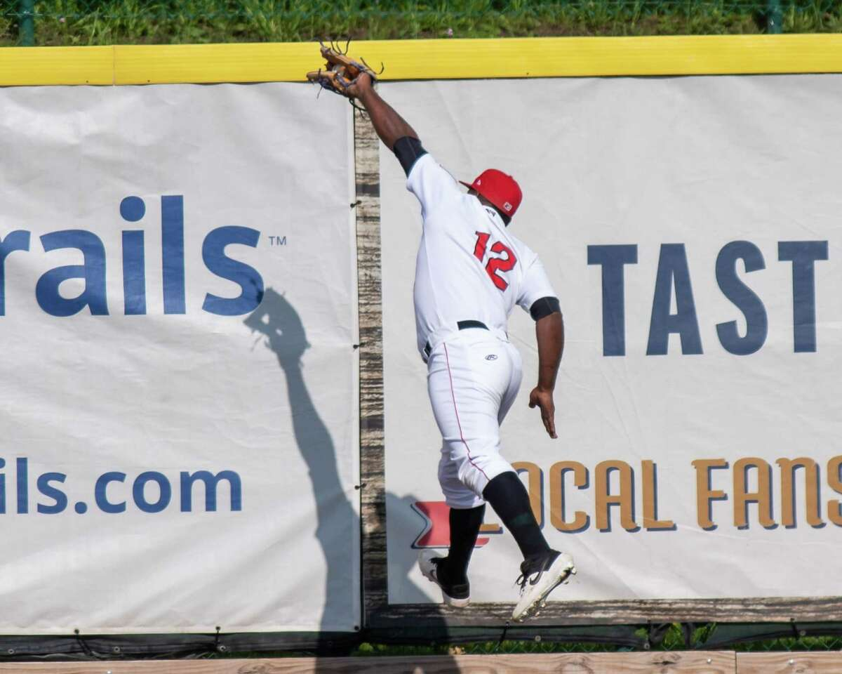 Tri-City ValleyCats Denis Phipps makes a leaping catch at the right field wall against the New York Boulders at the Joseph L. Bruno Stadium on the Hudson Valley Community College campus in Troy, NY, on Wednesday, July 28, 2021. (Jim Franco/Special to the Times Union)
