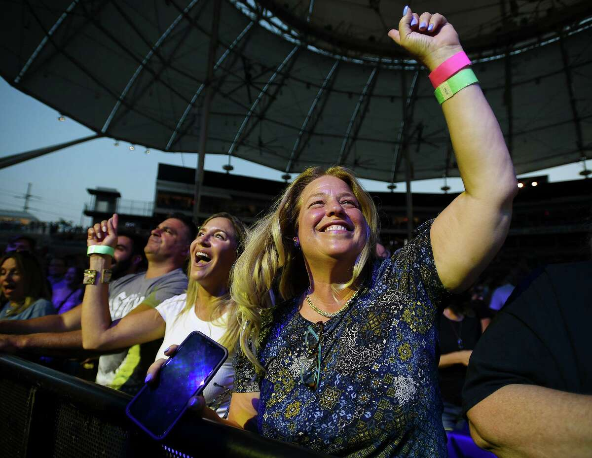 Superfans who first met at a Styx concert, Monica Lynn, left, of Stamford, and Shari Jacobson, of Cresskill, N.J., cheer on their favorite band from the front row on opening night Wednesday of the new Hartford HealthCare Amphitheater, the former Harbor Yard Ballpark, in Bridgeport.