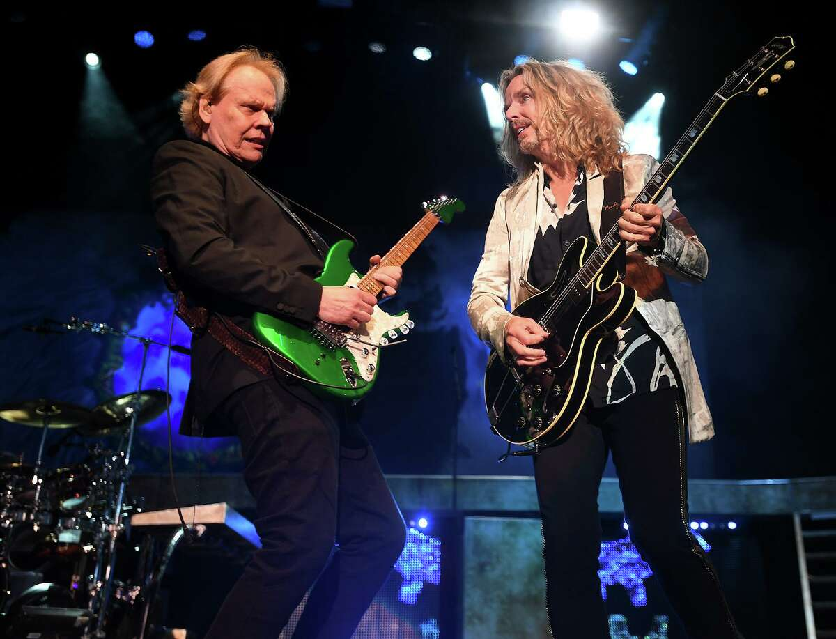 """James """"J.Y."""" Young, left, and Tommy Shaw perform with the classic rock band Styx on opening night Wednesday of the new Hartford HealthCare Amphitheater in Bridgeport"""