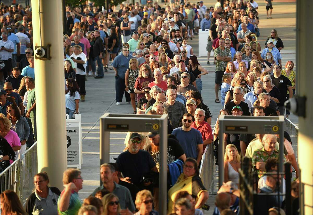A sold out crowd waits in line to get in for the double bill of classic rock acts REO Speedwagon and Styx on the opening night of the new Hartford Healthcare Amphitheater, a conversion of the former Harbor Yard Ballpark, in Bridgeport, Conn. on Wednesday, July 28, 2021.