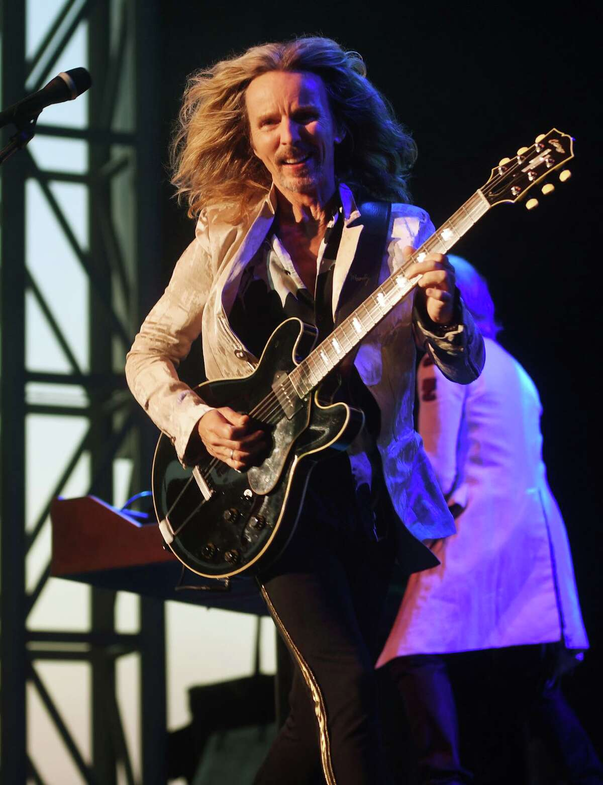Tommy Shaw of the classic rock band Styx performs on the opening night of the new Hartford HealthCare Amphitheater in Bridgeport on Wednesday Below left, Meriden friends, from left, Brian Daniels, Tracy Ivers, and Margarita Grignano take a selfie in front of the stage on opening night of the Hartford HealthCare Amphitheater in Bridgeport.