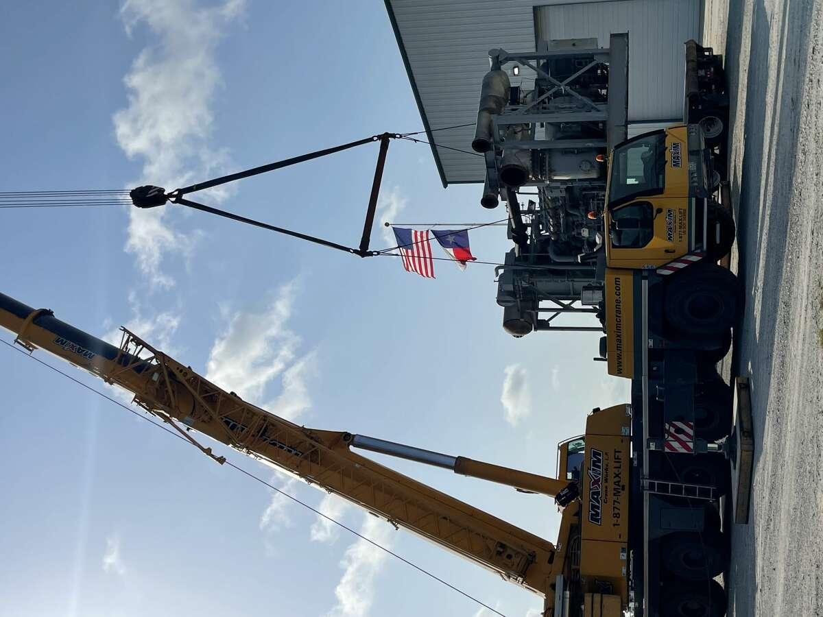 The NOMAD desalination unit is loaded onto a trailer to be taken to a refurbishment center.