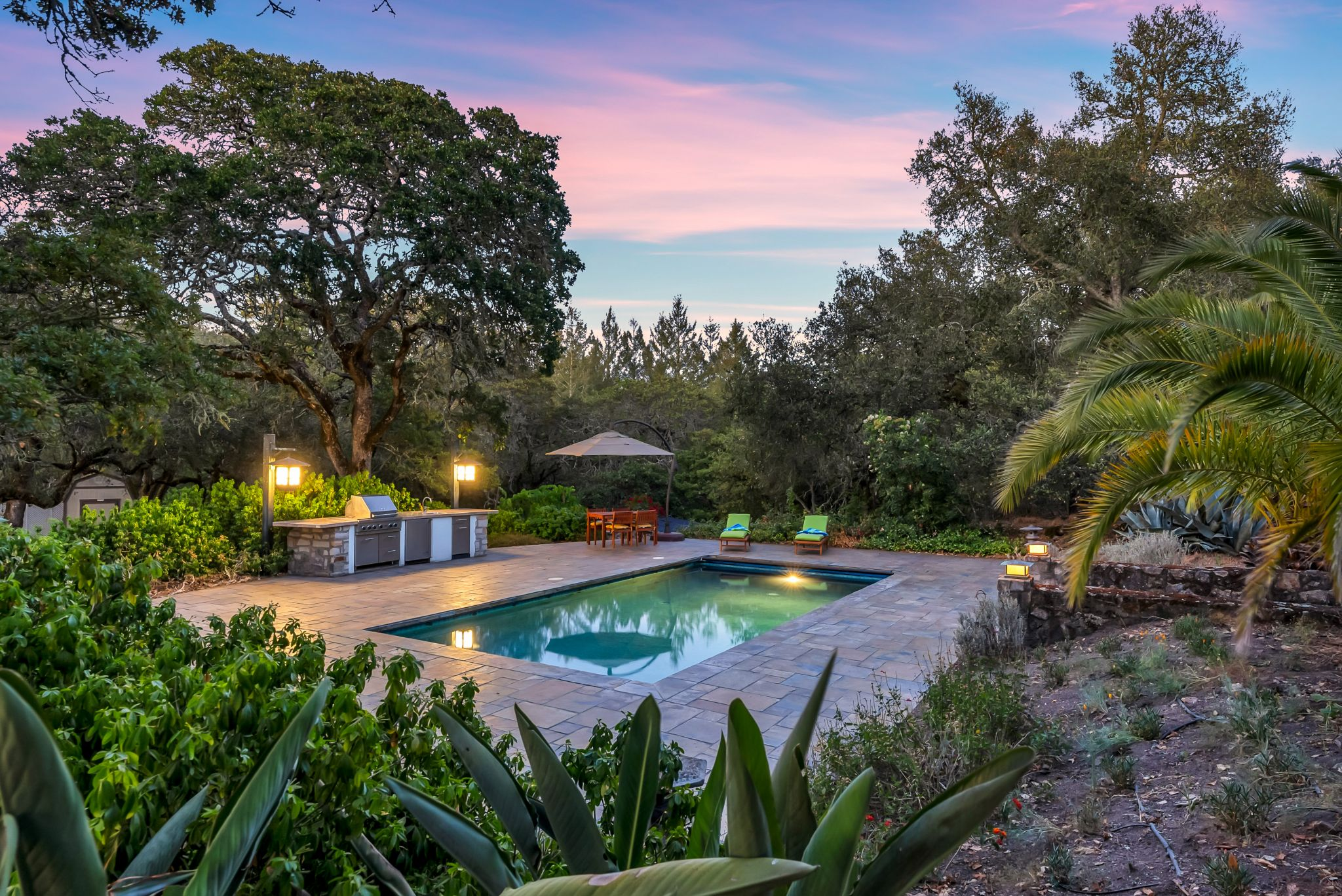 The pool, surrounded by palms, is a private oasis. An outdoor kitchen and patio complete the serene setting. Anna Marie Erwert writes from both the renter and new buyer perspective, having (finally) achieved both statuses. She focuses on national real estate trends, specializing in the San Francisco Bay Area and Pacific Northwest. Follow Anna on Twitter: @AnnaMarieErwert.