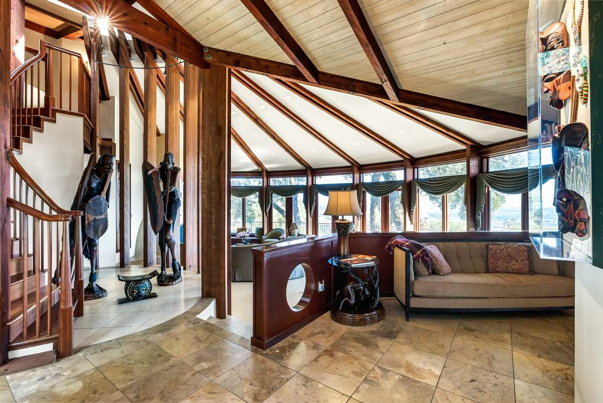 It's a custom built abode, with a unique geometric design and exposed beam accents.