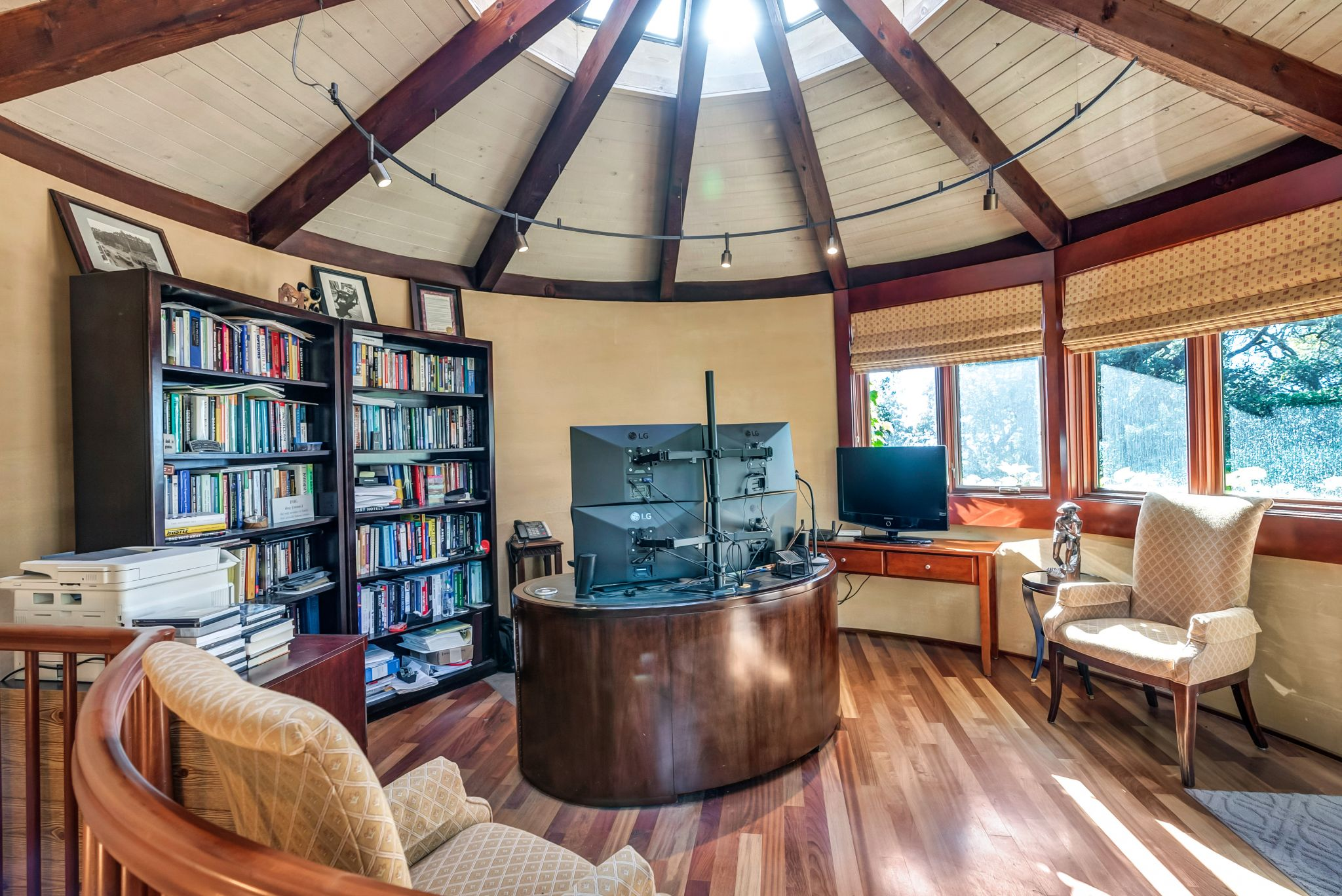 An office and library under this conical ceiling and skylight make for a unique work-from-home experience.