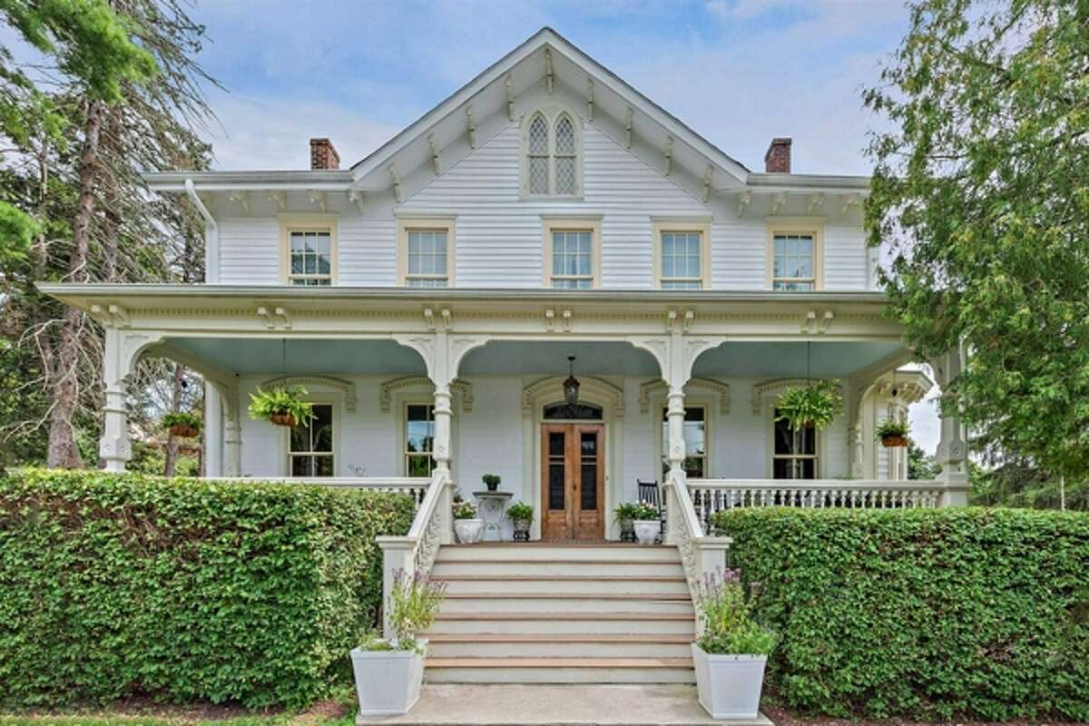 This restored 1870 Victorian is just a short walk from the New Hamburg train station and the Hudson River, located at 20 Main Street, New Hamburg, in the southwestern corner of the Town of Poughkeepsie.