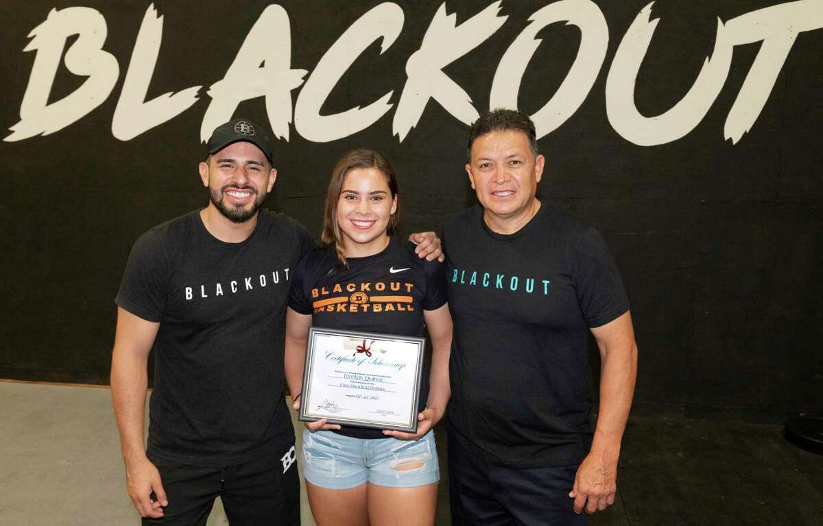 C.J. Martinez, Evelyn Quiroz and Daniel Quiroz are pictured Tuesday, July 27, 2021 as Evelyn is presented with a $500 Blackout Athletics Scholarship.
