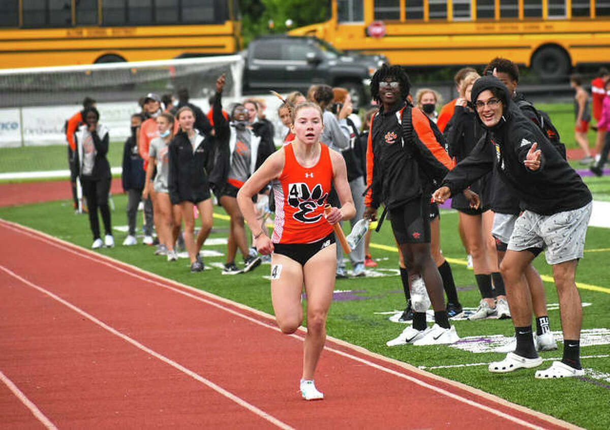 Edwardsville's Riley Knoyle runs the final leg of the 3,200-meter run during the Madison County Meet at Collinsville High School.