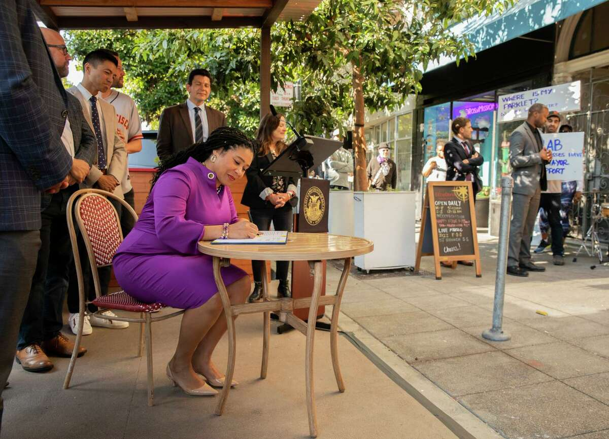 San Francisco Mayor London Breed signs legislation to makes the city's parklets permanent in a ceremony at the parklet outside Etcetera Wine Bar in the Mission.