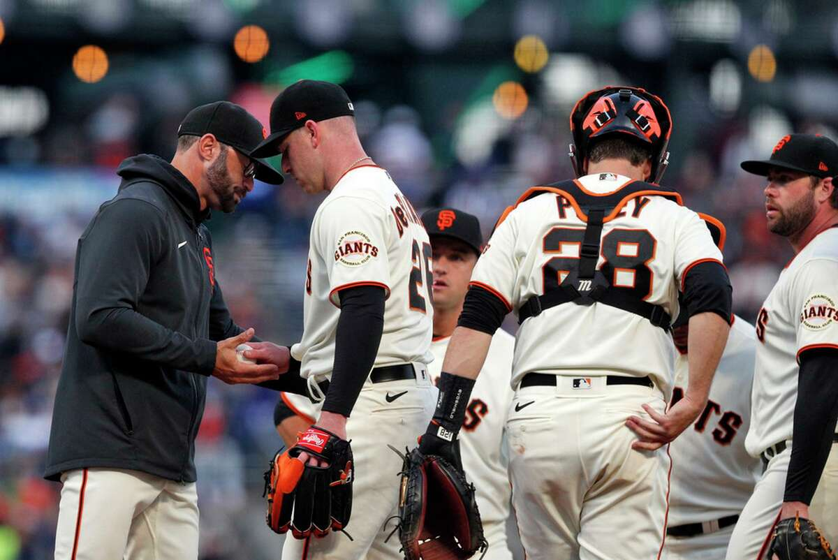 Giants manager Gabe Kapler (19) takes the ball from Anthony DeSclafani (26) in the third inning as the San Francisco Giants played the Los Angeles Dodgers at Oracle Park in San Francisco, Calif., on Wednesday, July 28, 2021.