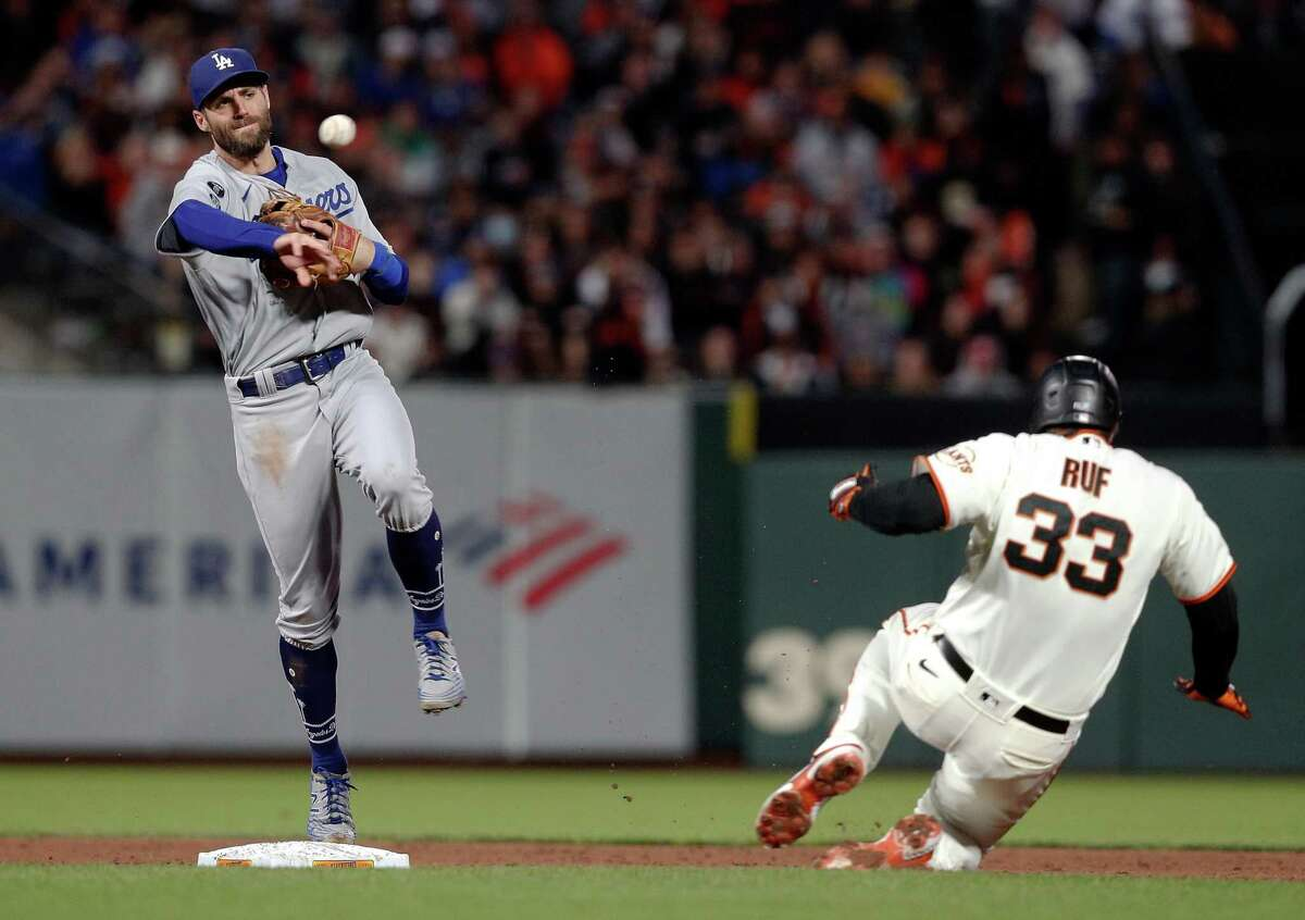 Chris Taylor (3) starts a double play on a ball hit by Jason Vosler (32) in the fifth inning as the San Francisco Giants played the Los Angeles Dodgers at Oracle Park in San Francisco, Calif., on Wednesday, July 28, 2021.