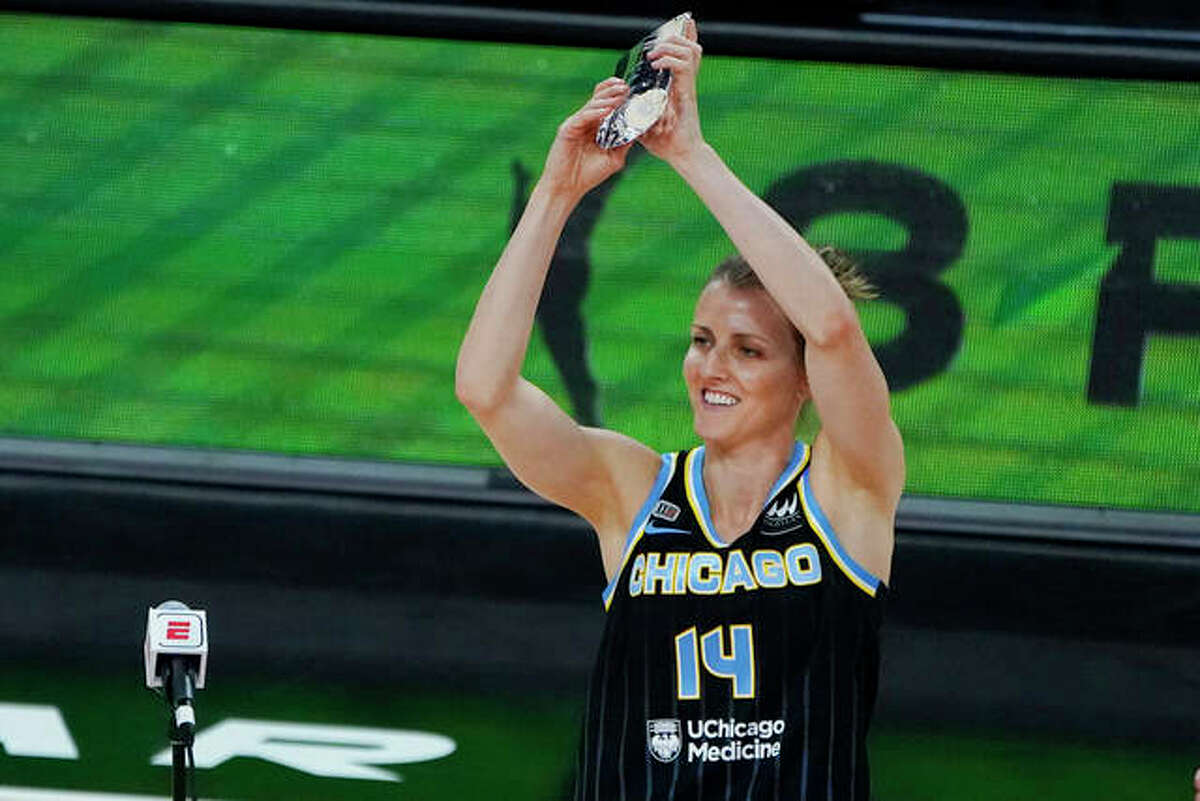Allie Quigley of the Chicago Sky holds up a trophy after winning the 3-point contest during halftime of a WNBA All-Star basketball game, Wednesday, July 14, 2021, in Las Vegas.