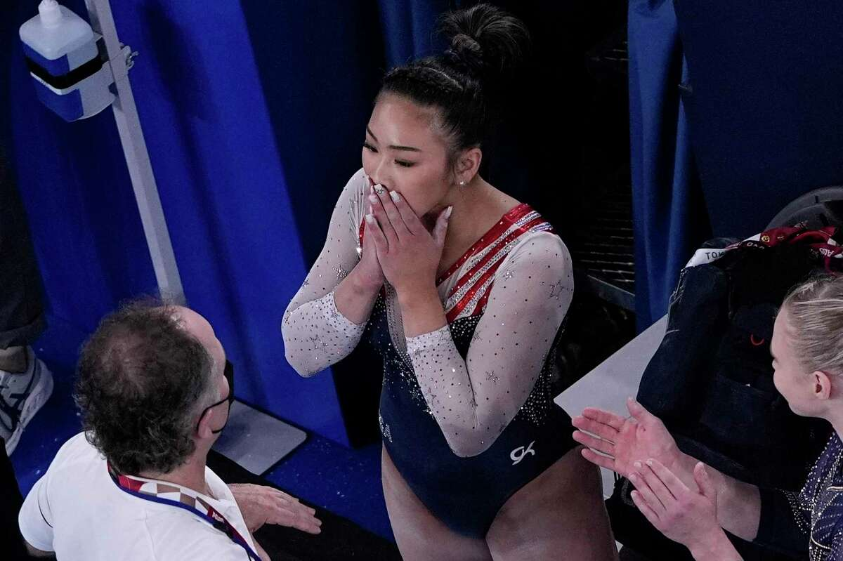 Sunisa Lee, of the United States, reacts after getting her score on the floor performs on the during the artistic gymnastics women's all-around final at the 2020 Summer Olympics, Thursday, July 29, 2021, in Tokyo. (AP Photo/Morry Gash)