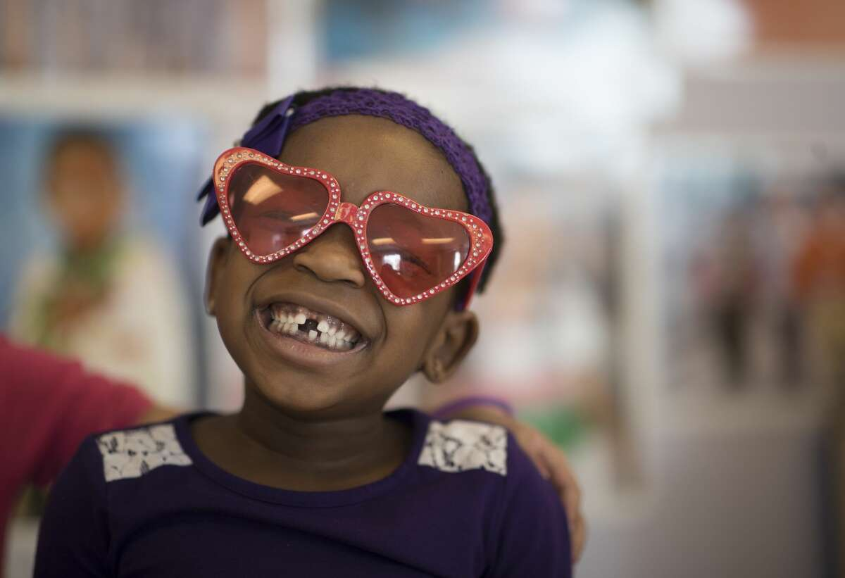FILE - Malaya Perry tried on a pair of heart shaped sunglasses at the early childhood services center at Phyllis Wheatley Community Center Wednesday Feb 14, 2018 in Minneapolis, MN.(Photo By Jerry Holt/Star Tribune via Getty Images)