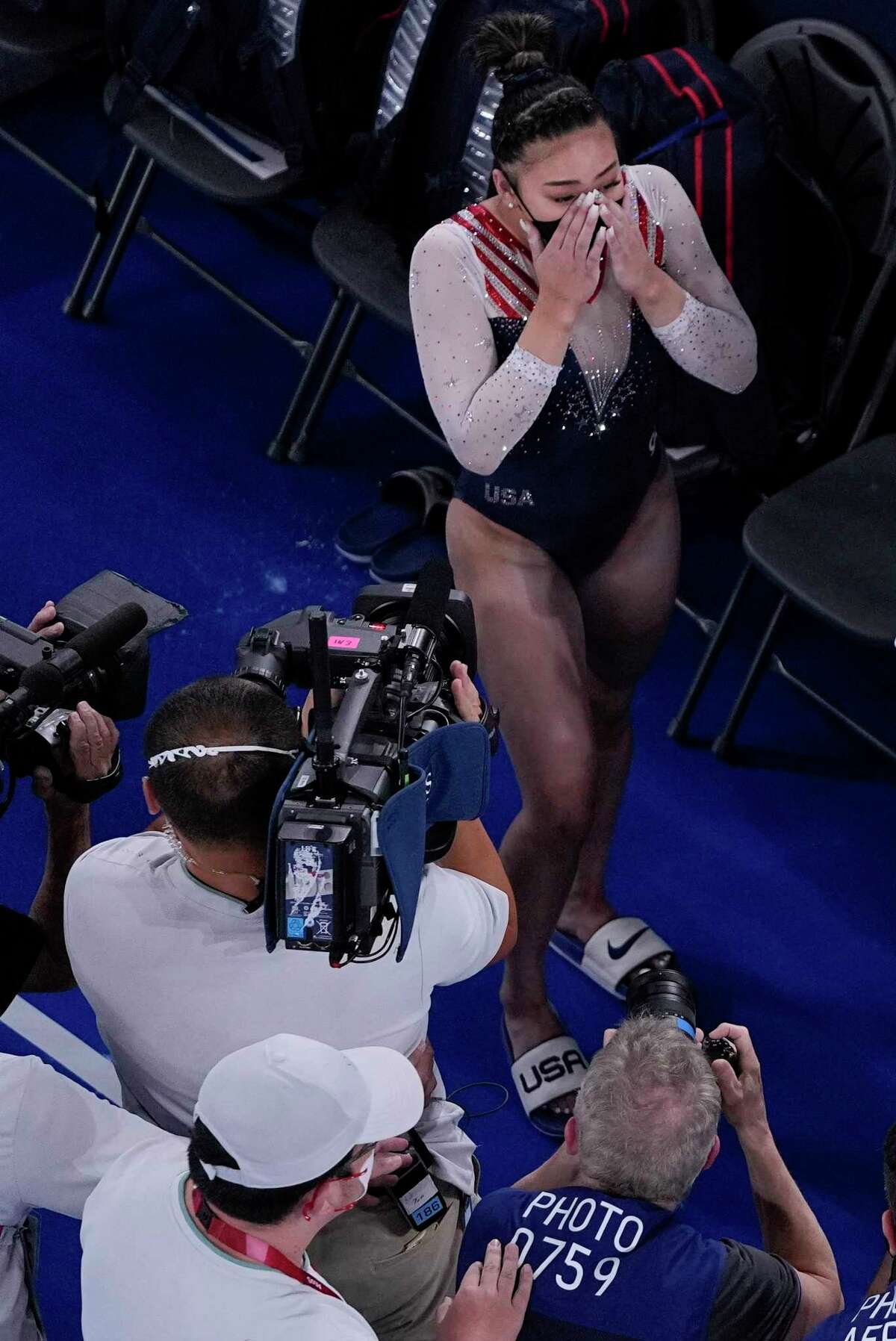 Sunisa Lee, of the United States, reacts as she learns she won the gold medal during the artistic gymnastics women's all-around final at the 2020 Summer Olympics, Thursday, July 29, 2021, in Tokyo.