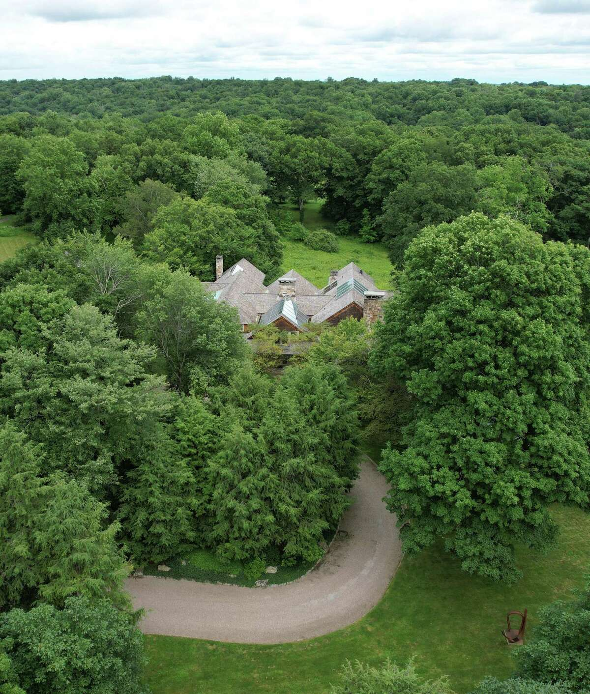 The home at 100 Sterling Rd. in Greenwich, Conn. Monday, July 19, 2021. The home is the site of a 2009 murder and was listed for sale at $35 million.