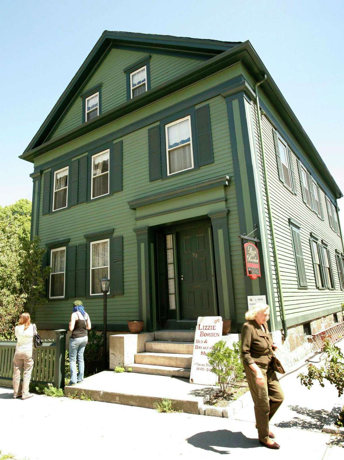 In this Aug. 20, 2008 photo, passers-by walk in front of the Lizzie Borden Bed and Breakfast, in Fall River, Mass.