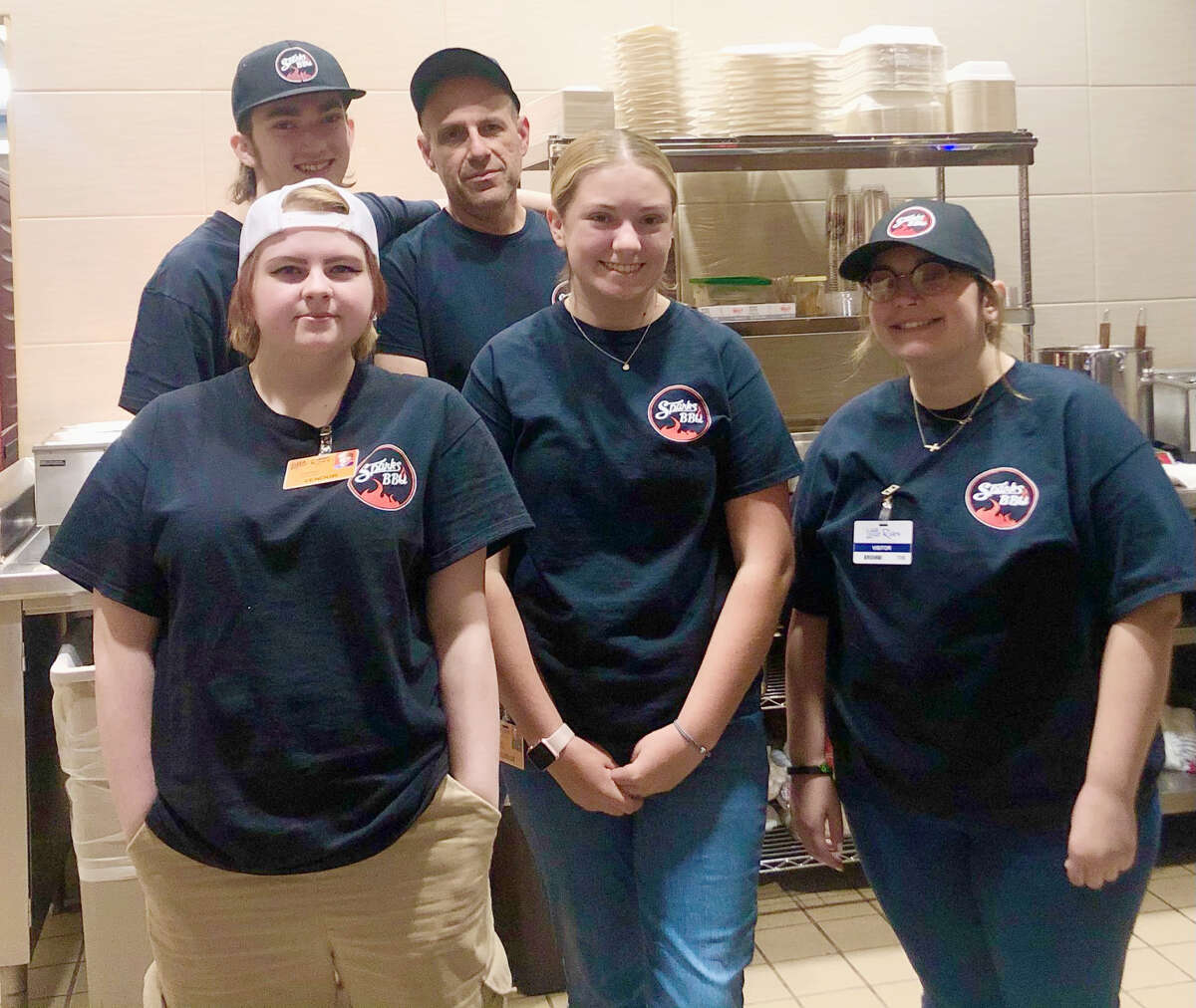 Sparks BBQ is located inside the Little River Casino Resort. Pictured are employees (front row, left to right) Jordan Wood, Emalyn Nelson, Keegan Gramza; (back row) Andrew Rabb and Andy Didato.
