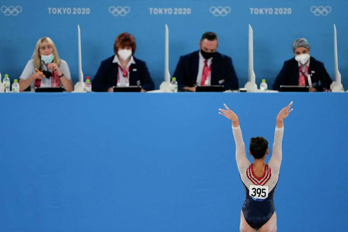 Sunisa Lee, of United States, performs on the floor during the artistic gymnastics men's all-around final at the 2020 Summer Olympics, Thursday, July 29, 2021, in Tokyo, Japan. (AP Photo/Ashley Landis)