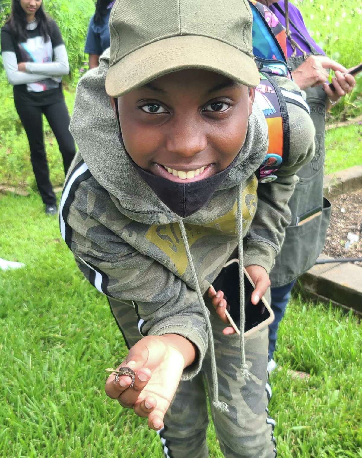One of the students on the tour, Erin, made friends with the amphibians.