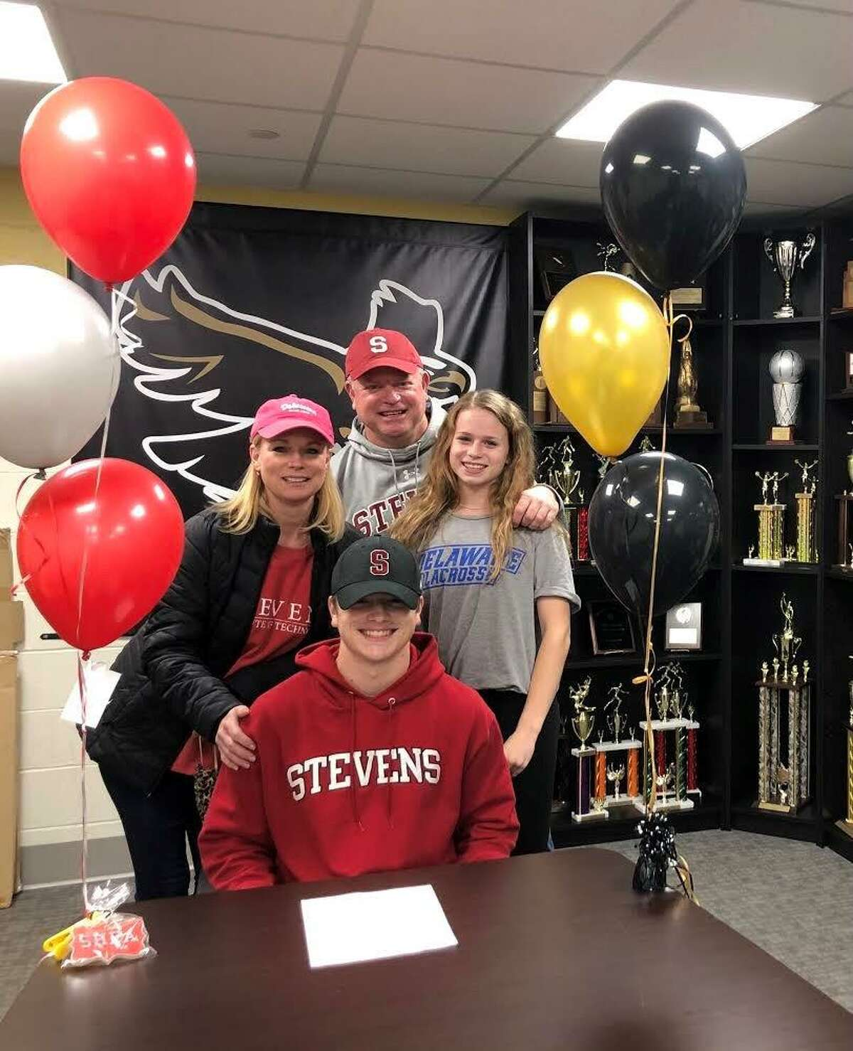 Shea Grant is surrounded by mom Stacey, dad Tim and sister Keira. He will play lacrosse at Stevens Institute of Technology. Twin sister Keira will play at the University of Delaware.