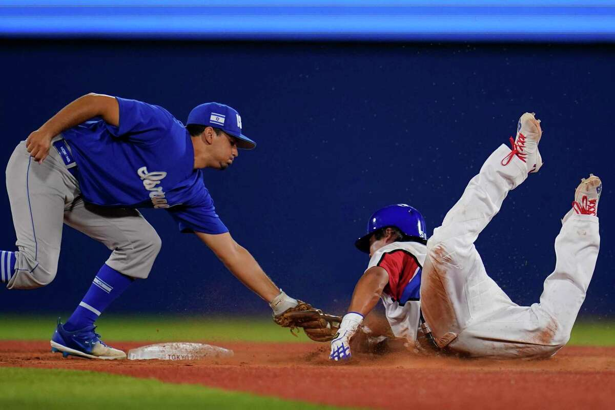 South Korea's Baekho Kang, right, is tagged out by Israel's Scott Burcham while trying to steal second in the ninth inning of a baseball game at the 2020 Summer Olympics, Thursday, July 29, 2021, in Yokohama, Japan. (AP Photo/Sue Ogrocki)