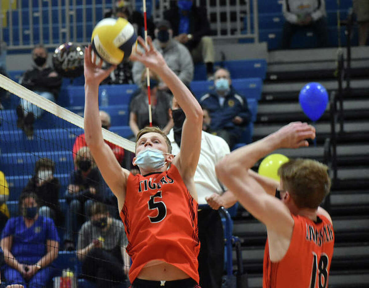 Edwardsville senior Preston Weaver sets a pass near the net for a teammate during a Southwestern Conference match against O'Fallon.
