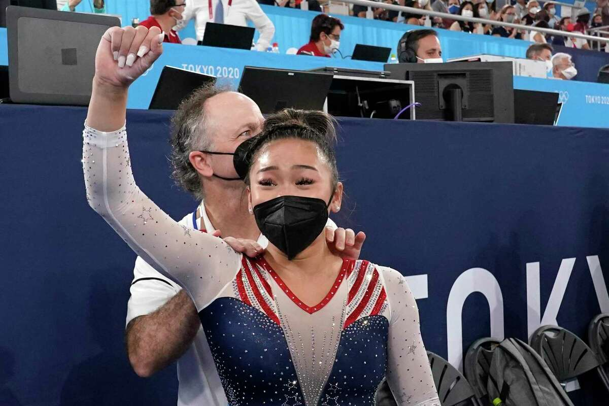 Sunisa Lee, of the United States, celebrates with her coach Jeff Graba after she won the gold medal in the artistic gymnastics women's all-around at the 2020 Summer Olympics, Thursday, July 29, 2021, in Tokyo.