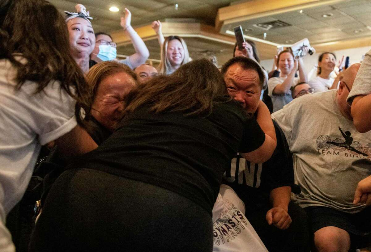 OAKDALE, MN - JULY 29: John Lee (C), father of Sunisa Lee of Team United States, celebrates after she won gold in the Women's All-Around Gymnastics Final on day six of the Tokyo 2020 Olympic Games at a watch party on July 29, 2021 in Oakdale, Minnesota. (Photo by Stephen Maturen/Getty Images)
