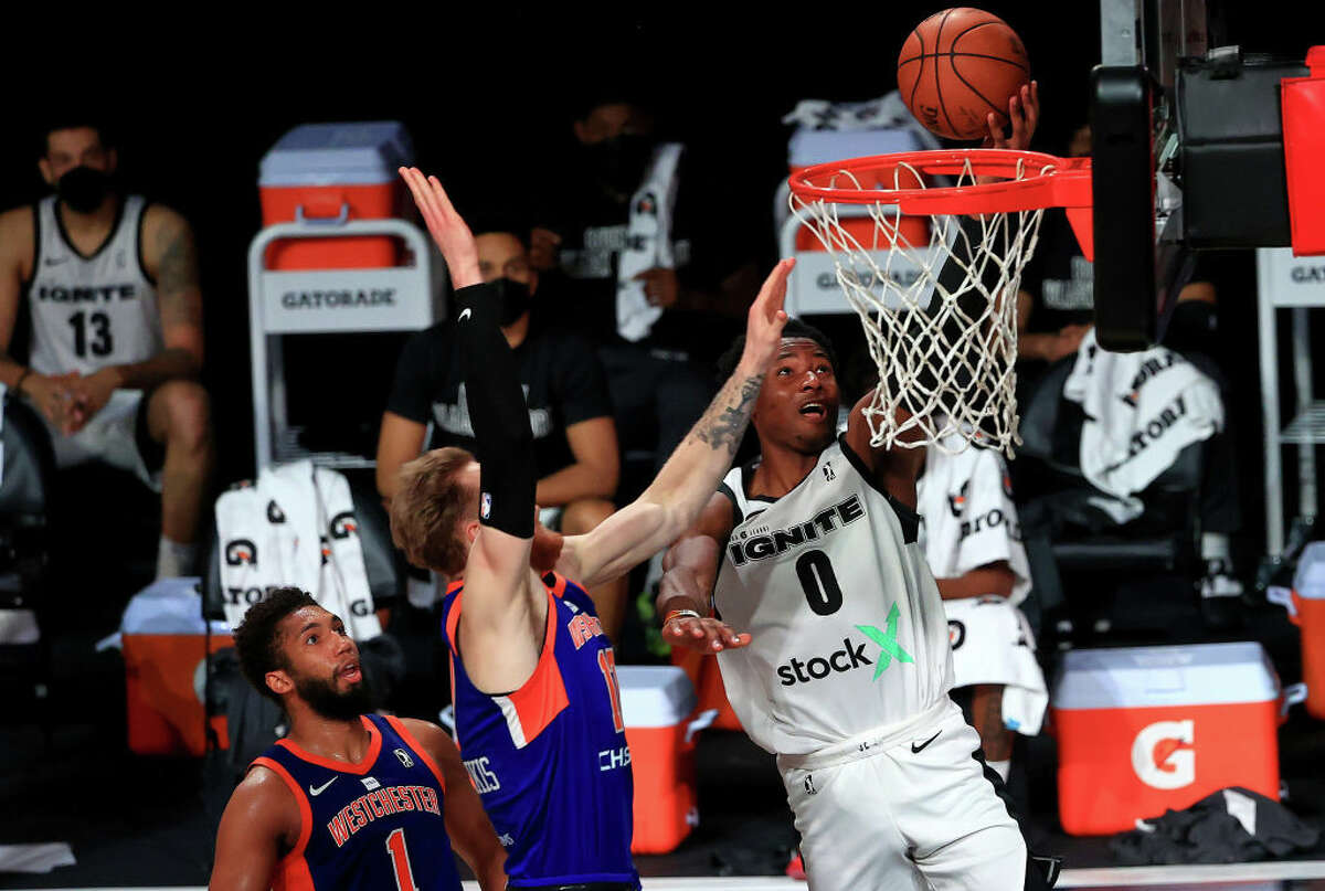 Jonathan Kuminga, right,of the G League Ignite drives to the basket during a G-League game against the Westchester Knicks at AdventHealth Arena at ESPN Wide World Of Sports Complex on Feb. 18, 2021, in Lake Buena Vista, Fla.