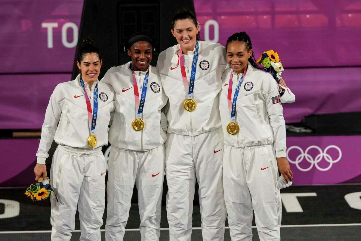 Team United States, left to right, Kelsey Plum (5) of Team United States, Jacquelyn Young (8) of Team United States, Stefanie Dolson (13) of Team United States and Allisha Gray (15) of Team United States accept their gold medals after winning the 3x3 Basketball final against ROC on day five of the Tokyo 2020 Olympic Games at Aomi Urban Sports Park on July 28, 2021 in Tokyo. MUST CREDIT: Washington Post photo by Toni L. Sandys