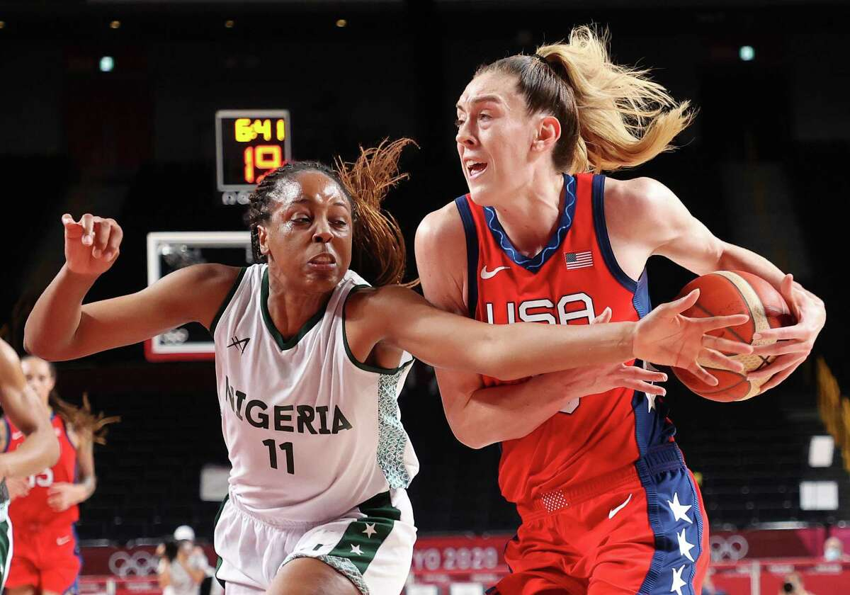 SAITAMA, JAPAN - JULY 27: Breanna Stewart #10 of Team United States drives to the basket against Adaora Elonu #11 of Team Nigeria during the second half of a Women's Preliminary Round Group B game on day four of the Tokyo 2020 Olympic Games at Saitama Super Arena on July 27, 2021 in Saitama, Japan. (Photo by Gregory Shamus/Getty Images)