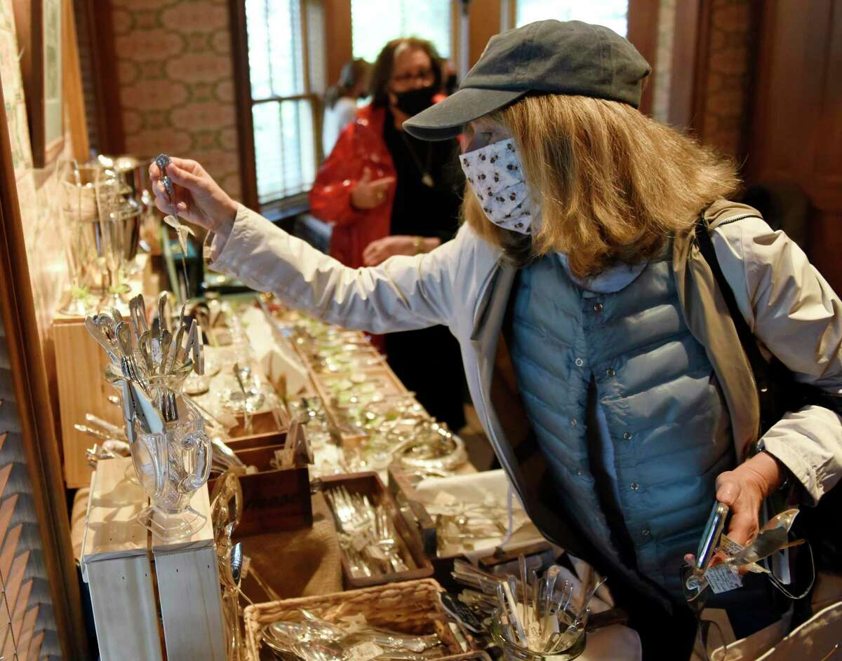 """Riverside's Kathy McCormack browses Jean Forte Gifts booth at the Garden Markets in the Tavern Garden at the Grenwich Historical Society in the Cos Cob section of Greenwich, Conn. Wednesday, May 5, 2021. The market will be held on alternating Wednesdays rain or shine featuring all things """"Home"""" - from food and flowers to specially curated items that enrich life enjoyed with family and friends."""