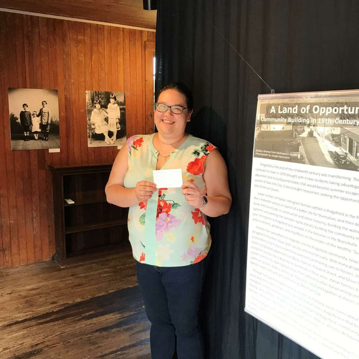 """Keeler Tavern Museum & History Center's Chief Curator and Assistant Museum Director Catherine Prescott is ready to contribute her story to a new community-sourced exhibit on display in the Carriage Barn. The exhibit, """"A Land of Opportunity? Community Building in 19th Century Ridgefield,"""" runs through Sept. 18."""