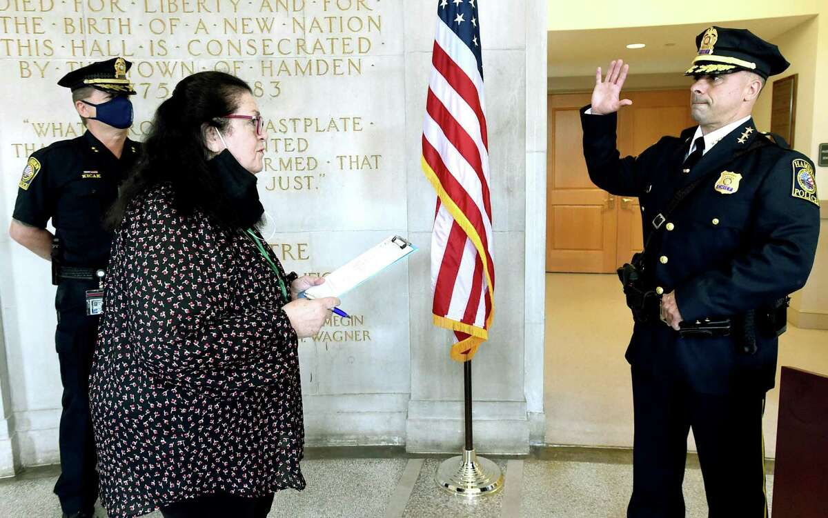 Hamden Town Clerk Vera Morrison, pictured swearing in John Sullivan as acting police chief, plans to retire after 26 years, according to Mayor Curt Balzano Leng. Two Democrats are vying for her position in the 2021 municipal election, and a Republian may join the ballot in November.