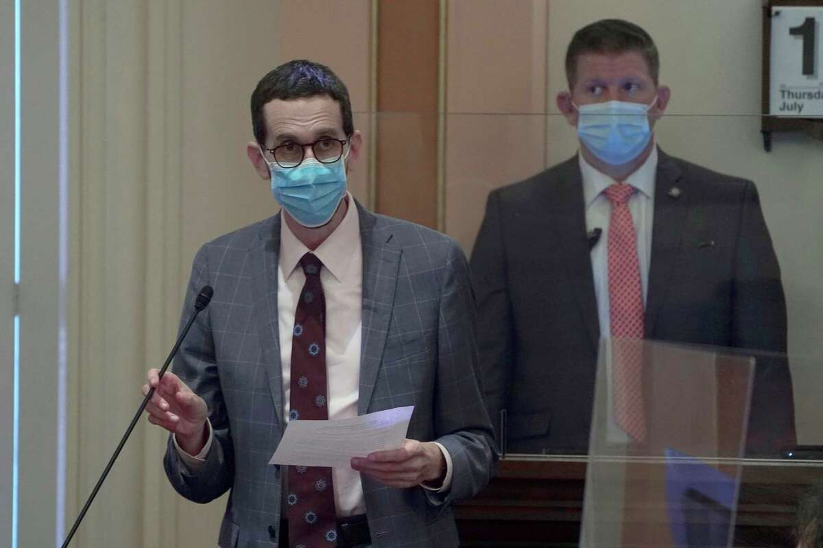 State Sen. Scott Wiener, D-San Francisco, wears a face mask as he speaks on the floor of the Senate in Sacramento this month. Face masks were already required at the Capitol; now all of Sacramento County will require them.