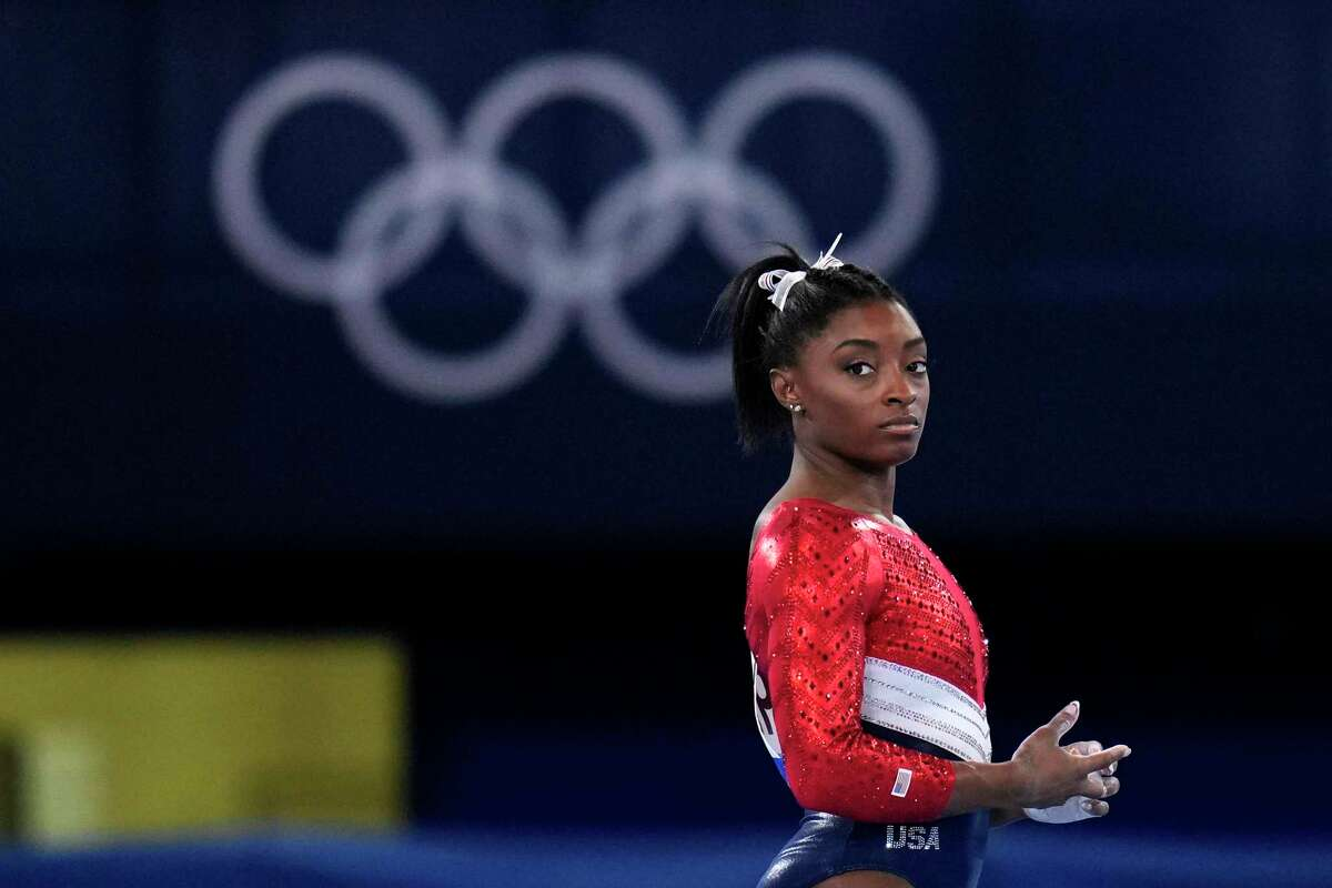 This July 27, 2021, file photo shows Simone Biles, of the United States, waiting to perform on the vault during the artistic gymnastics women's final at the 2020 Summer Olympics, Tuesday, July 27, 2021, in Tokyo.