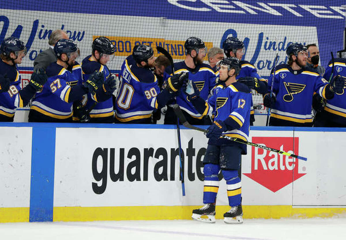 The Blues' Jaden Schwartz (17) celebrates with Ryan O'Reilly (90) and other teammates after scoring a goal last May against the Minnesota Wild in St. Louis.