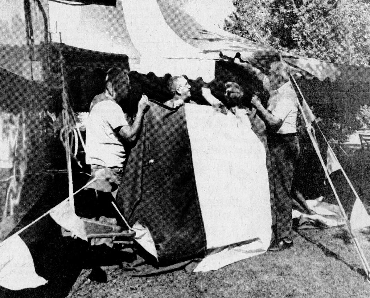(From left) Members of the Onekama Lions, Pete Skimin (left), Joe Pattison, Charles Stevenson, and chairman of Onekama Days Evert Hopwood put the finishing touches on the refreshment tent prior to this weekend's celebration. The photo was published in the News Advocate on July 30, 1981. (Manistee County Historical Museum photo)