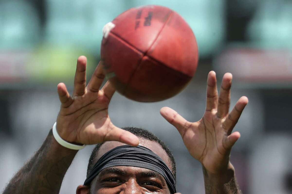 Houston Texans wide receiver Keke Coutee reaches up to catch a ball during an NFL training camp football practice Thursday, July 29, 2021, in Houston.