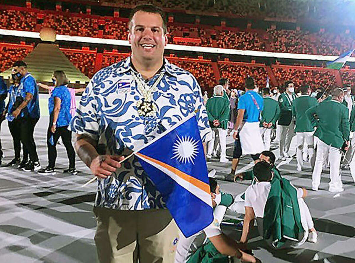 Johnathan Jordan, swim coach at Lincoln College as well as swim coach for the tiny Marshall Islands, at the Opening ceremonies of the Tokyo Summer Olympic Games. Johnson is the husband of Alton native Amber Sorgea.