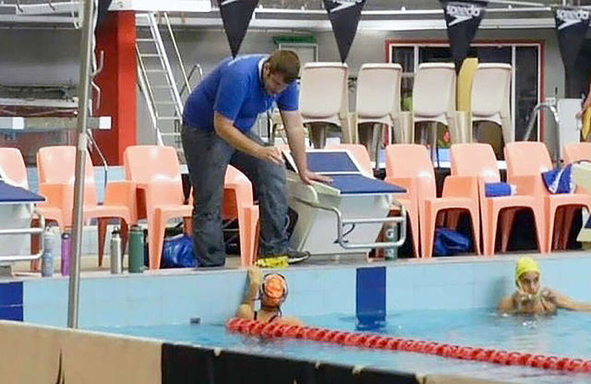 Johnathan Jordan coaching during an Olympics workout session earlier this week in Tokyo.