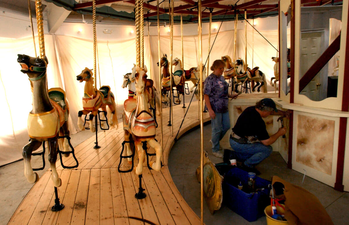 Carousel artist William Finkenstein, right, and his companion Karen Jacquot work on the carousel site Tuesday, June 4, 2002, at Congress Park in Saratoga Springs, N.Y. (Times Union staff photo by Cindy Schultz)