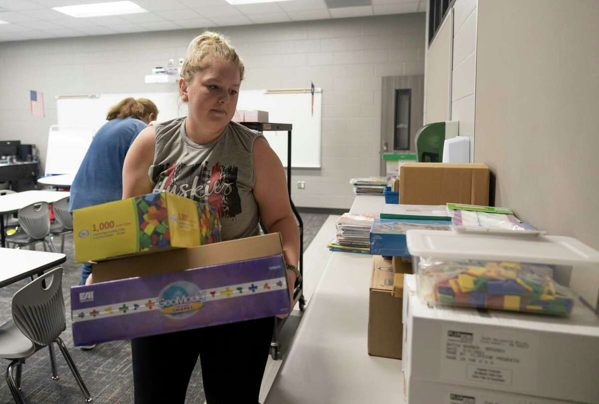 Kaitlin Springer, kindergarten teacher, lays boxes of supplies in a classroom at the new Hope Elementary.